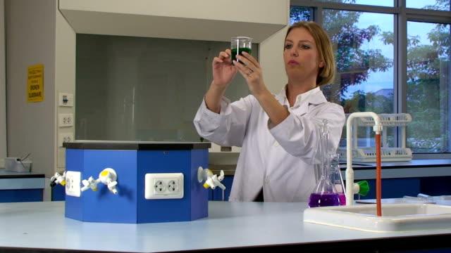 lab work - laboratory coat stock videos & royalty-free footage