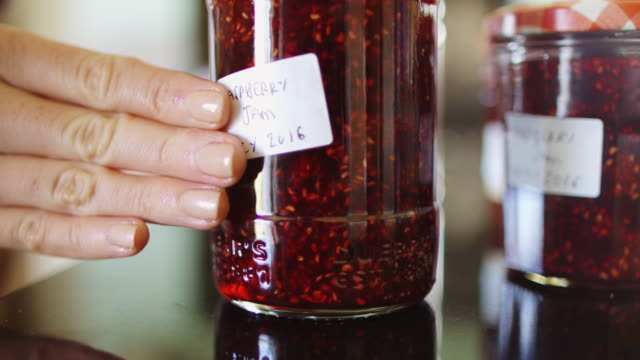 labelling jar of jam - preserve stock videos and b-roll footage