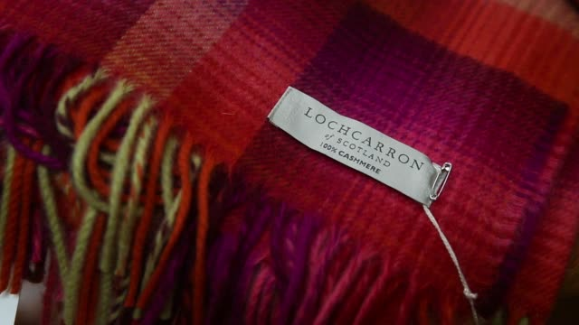 labels sit on completed tartan neck ties hanging in the storehouse following completion at lochcarron john buchan ltds production plant in selkirk uk... - tartan stock videos & royalty-free footage