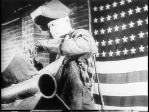 labor day 1942 salute to labor / image of 'free labor will win' slogan and welder against a flag on brick wall / real welder against flag moves flips... - ziegel stock-videos und b-roll-filmmaterial