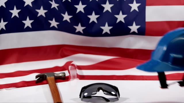 vídeos de stock e filmes b-roll de labor day.american flag - dia do trabalhador