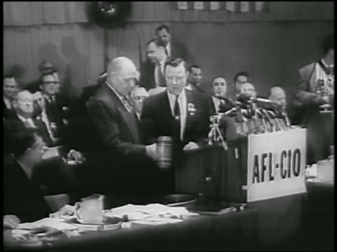 labor leaders hitting gavel together at afl-cio merger - 1955 video stock e b–roll