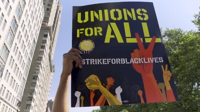 labor unions workers rallied outside the trump international hotel & tower at columbus circle in manhattan, new york city to protest systemic racism... - social justice concept bildbanksvideor och videomaterial från bakom kulisserna