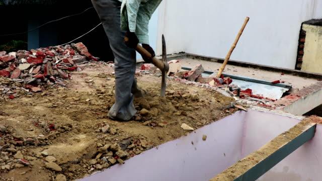 labor working on construction site! - slum stock videos & royalty-free footage