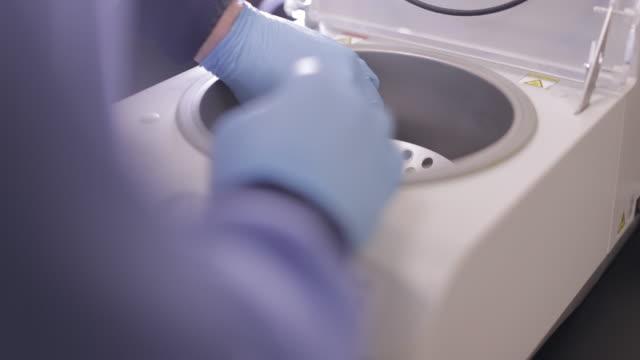 laboratory centrifuge - removing the centrifuge tubes - centrifuge stock videos & royalty-free footage