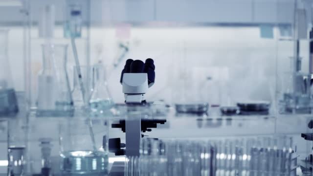 laboratory equipment. microscope and glassware - indoors stock videos & royalty-free footage