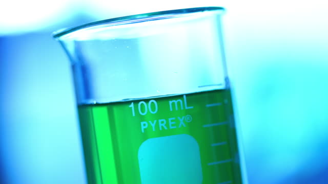 laboratory glassware with color liquid - laboratory glassware stock videos & royalty-free footage