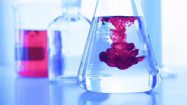 laboratory glassware with color liquid