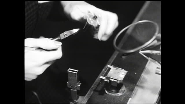 laboratory technician checking on complex machinery; wire going through coating process; woman assembling vacuum tubes and close up on her hands - 1940 1949 stock videos & royalty-free footage