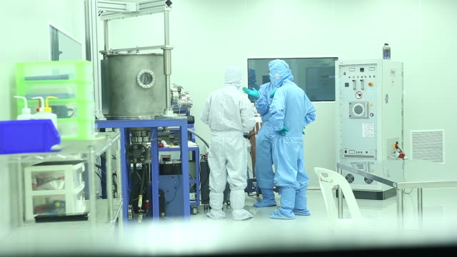 laboratory technicians working in clean room - clean room stock videos and b-roll footage
