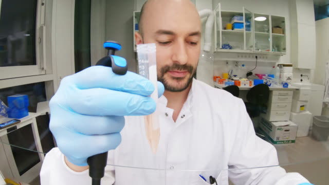 laboratory work - pipette stock videos & royalty-free footage