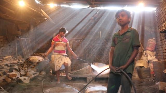 Laborer seen working Ship Propeller making yard in Dhaka