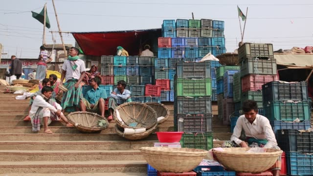Laborer waits for work at a temporary wholesale market at the bank of the Buriganga River in Dhaka Bangladesh on March 19 2018 The chemical waste of...