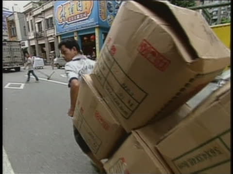 laborers in a small province in southern china pull heavily laden carts. - westernisation stock videos & royalty-free footage