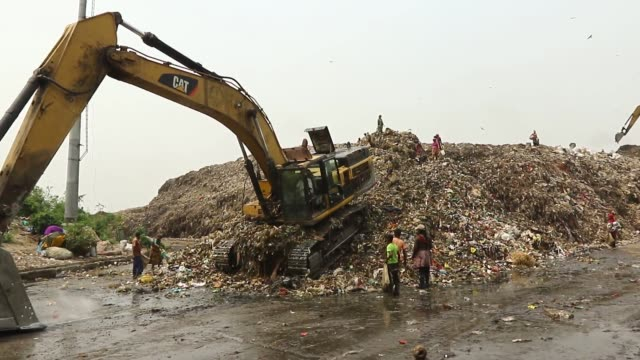 laborers pick the non biodegradable waste to be used for the recycling industry in dump yard in dhaka it is a place that in guaranteed to play havoc... - rubbish dump stock videos & royalty-free footage