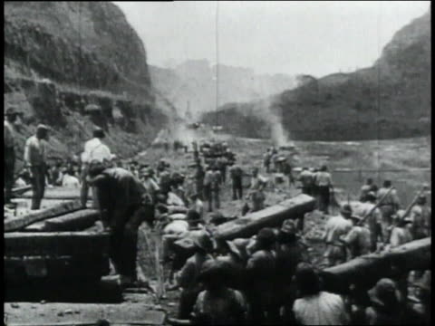 ws laborers piling up wooden beams / republic of panama - 1906 stock-videos und b-roll-filmmaterial