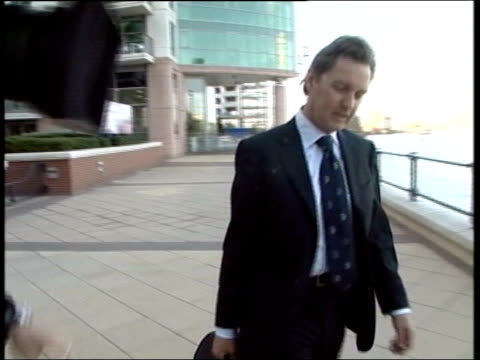 london alan milburn mp standing outside building talking to press milburn towards along by thames pan int milburn towards thru underpass with other... - underpass stock videos and b-roll footage