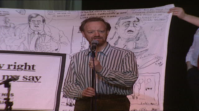 labour conference at brighton: day 4 - day 6; 6.10.89 england: brighton: int red review: robin cook raffles nhs sheet covered with cartoons drawn by... - animation moving image stock videos & royalty-free footage