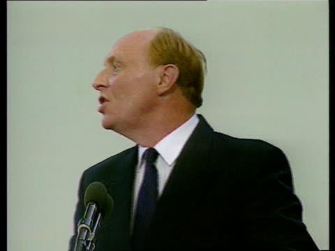 Neil Kinnock speech BBC MS Kinnock on conference platform waving TGV Conference audience clapping Neil Kinnock MP speech SOF Tories can delay...