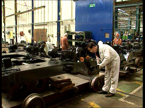 labour criticises government's rail privatisation scheme meridian hants eastleigh men working on wheel truck lms man operating lifting machinery... - floor length stock videos & royalty-free footage