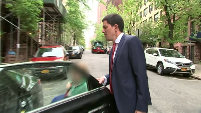 david miliband comments on his brother's leadership usa new york ext david miliband along to his car with young son zoom in as miliband round car and... - david miliband stock videos & royalty-free footage