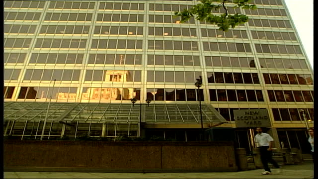 funding of city academies investigation des smith england london ext revolving sign 'new scotland yard' outside police hq low angle general view... - head teacher stock videos and b-roll footage