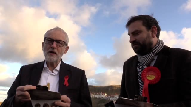 labour leader jeremy corbyn eats chips in whitby while on the general election campaign trail wearing a jacket that has for the many not the few... - whitby north yorkshire england stock videos & royalty-free footage