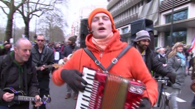 vídeos y material grabado en eventos de stock de labour leader jeremy corbyn joins antinuclear trident protest england london ext **music heard sot** protesters towards including man singing... - krishna