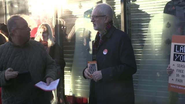 labour leader jeremy corbyn leaflets members of the public after his party announces plans to cut rail fares if they attain power after the... - nationalization stock videos & royalty-free footage