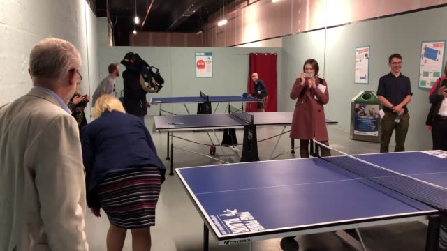 labour leader jeremy corbyn tries table tennis and plays guitar with rock of ages vocalist john newhouse during a visit to bolton to unveil new plans... - jeremy corbyn stock videos & royalty-free footage