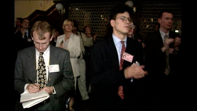 ed milband and david miliband profile 4101994 david miliband standing amongst audience and applauding as watching tony blair conference speech - david miliband stock videos & royalty-free footage