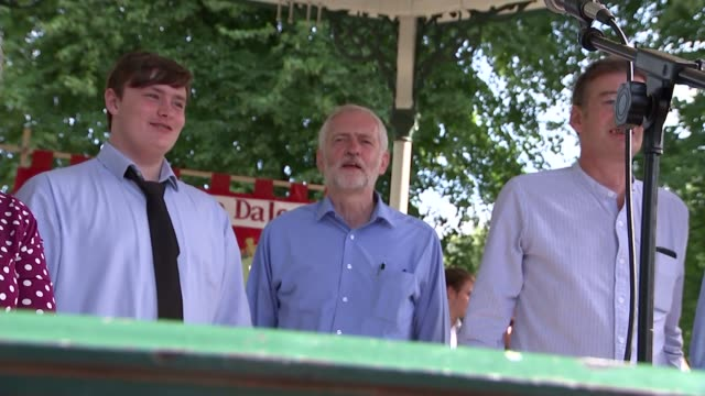 jeremy corbyn speech in matlock corbyn and others singing song 'the red flag' sot / red flag flying - singing contest stock videos and b-roll footage