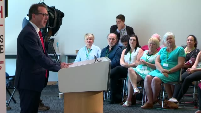 labour leadership contest: owen smith holds first big pitch speech; int owen smith mp entering room and along people at speech smith speaking at... - domande al primo ministro video stock e b–roll