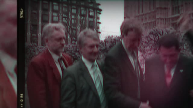 vídeos de stock, filmes e b-roll de polling closes dates old film sequence showing jeremy corbyn as young mp posing alongside other mps with then venezuelan president hugo chavez... - tony benn