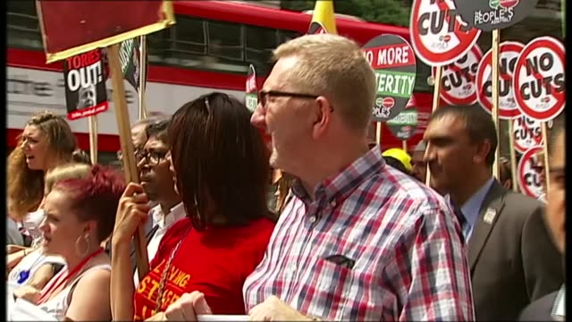 unite chief len mccluskey comments on future leader r21061404 / ext various of len mccluskey and other protesters marching along holding placards... - marching stock videos and b-roll footage