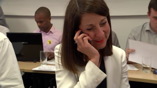 Voting begins ENGLAND London INT Varous shots of Labour activists making calls to get support for Liz Kendall Sticker 'Liz Kendall for Leader' on...