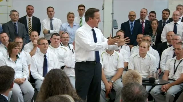 labour leadership criticised by backbencher over recent performance; 22.7.2013 england: london: int david cameron mp chattgin with staff during visit... - youth club stock videos & royalty-free footage