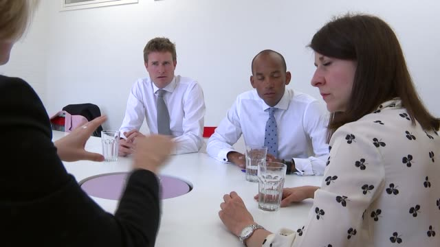 kendall interview; england: london: brixton: int labour leadership candidate liz kendall mp sat around table with supporters tristram hunt mp, chuka... - gloria de piero stock videos & royalty-free footage