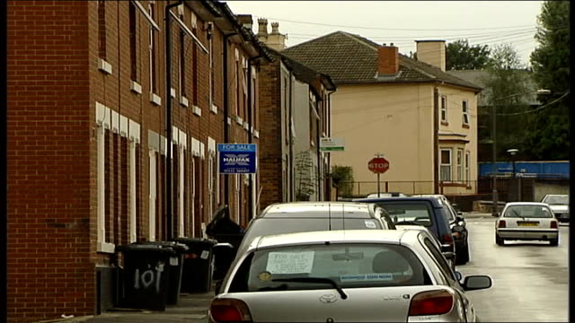 labour members defect to liberal democrats ext long shot cars along terraced street past parked cars fayeed hussain interview sot defections are a... - sour taste stock videos & royalty-free footage