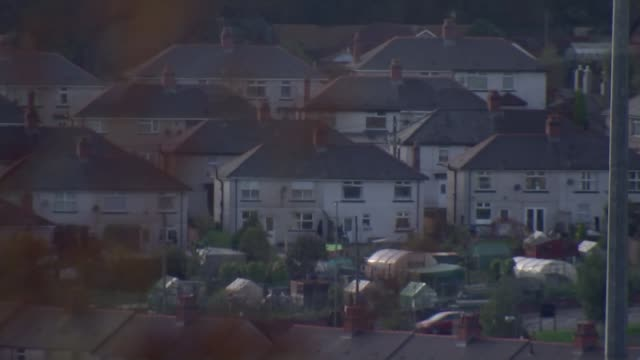 labour motion to reverse cut in tax credits; south wales: ext high angle gvs of houses - reverse motion stock videos & royalty-free footage