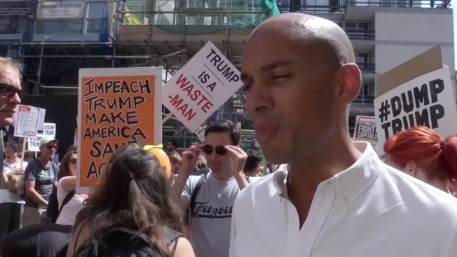 Labour MP for Streatham Chuka Umunna speaks to the media during the antiTrump protest march taking place in central London against the President's...