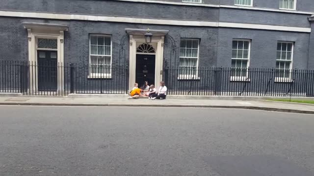 labour mp jess phillips drops her son off at number 10 to protest the closure of some schools on fridays due to budget cuts the birmingham mp says... - off stock videos & royalty-free footage