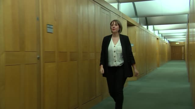 labour mp jess phillips set-up shots in her office; england: london: houses of parliament: int jess phillips mp along corridor and entering office - mp stock videos & royalty-free footage