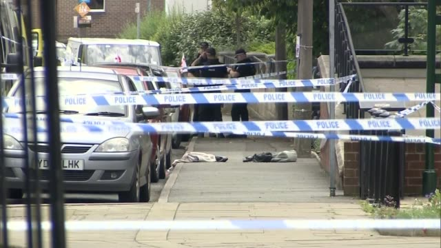 labour mp jo cox dies after being shot and stabbed in street attack england west yorkshire birstall ext debris and police tape cordons across street... - jo cox politician stock videos and b-roll footage