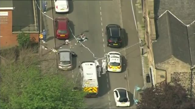 labour mp jo cox dies after being shot and stabbed in street attack air view forensic officers and police vehicles at crime scene - jo cox politician stock videos and b-roll footage