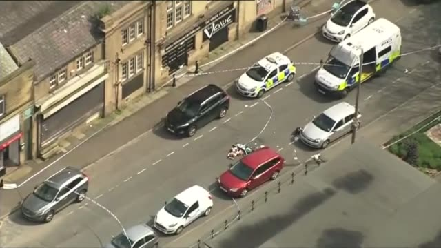 labour mp jo cox dies after being shot and stabbed in street attack air view / aerial police vehicles in cordonedoff street emergency medical... - emergency equipment stock videos & royalty-free footage