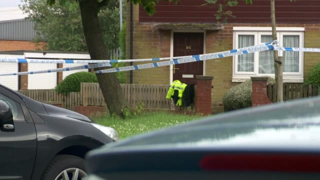 suspect tommy mair police tape cordon pull police tape cordons outside house england flags outside house pan police tape cordons outside house... - jo cox politician stock videos and b-roll footage