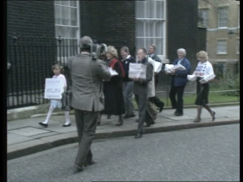 labour new policy document westminster downing st ms ann taylor mp michael cashman others carrying petition to no 10 - mp stock-videos und b-roll-filmmaterial