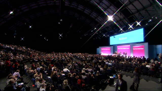 labour party annual conference: ed balls speech; england: manchester: int **beware flash photography** ed miliband mp asking people involved in... - ダグラス アレキサンダー点の映像素材/bロール