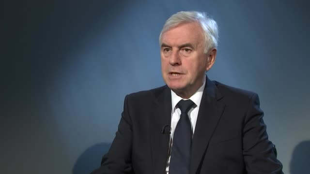 Shawcroft resigns as head of disputes panel / Corbyn misses Milton Keynes visit ENGLAND INT John McDonnell MP interview SOT